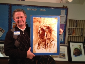 Ron Snowden demonstrating a painting done with instant coffee in less than an hour!